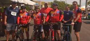 West employees tour de cure team